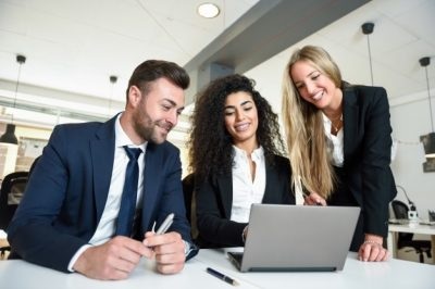 multi-ethnic-group-three-businesspeople-meeting-modern-office-two-women-man-wearing-suit-looking-laptop-computer_1139-967
